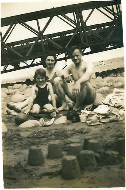 fam-and-sandcastle-near-bridge